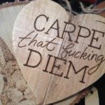 pyrographic carpe diem tattoo design on wood
