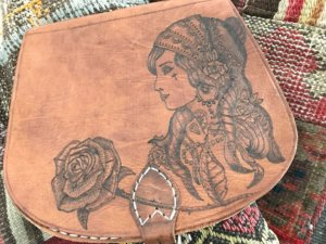 pyrographic-artwork-on-leather-traditional-tattoo-designs