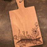 pyrographic artwork on wood cutting board