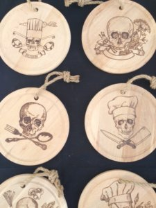pyrographic artwork on wood skull chef designs